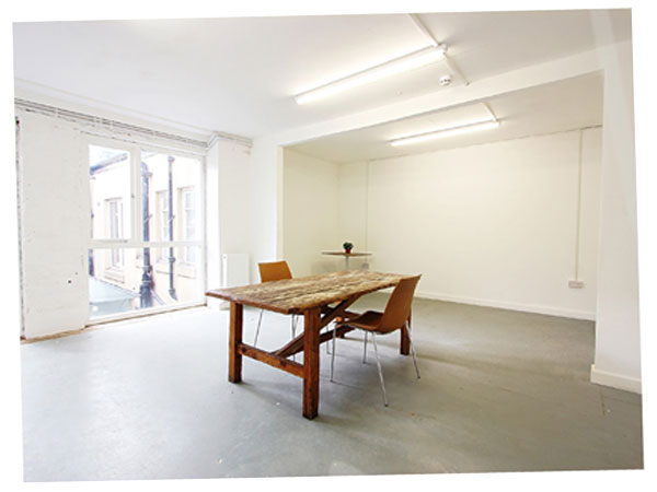 empty office for let south london with wooden table